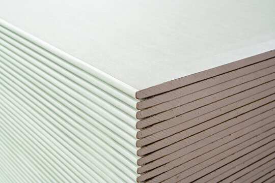 drywall sheets are stacked on top of each other. building material