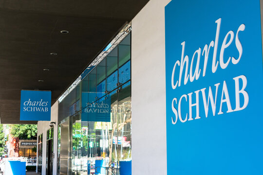 Charles Schwab sign on headquarters. Charles Schwab Corporation is an American bank and stock brokerage firm - San Francisco, California, USA - 2020
