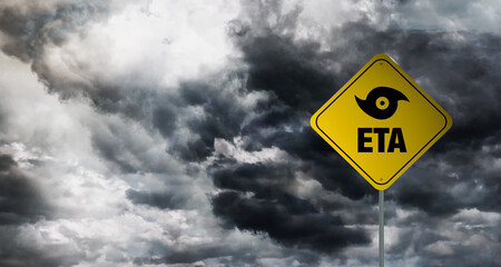 Hurricane Eta banner with storm clouds background.