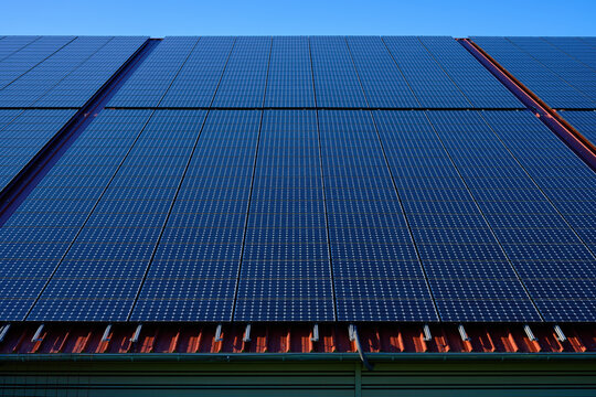 Solar Panels On A House Roof - Solar cells on a house roof, concept of green, alternative and self-sufficient power generation and electricity.