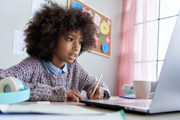 Cute smart african american school pupil kid girl virtual distance learning online watching remote...
