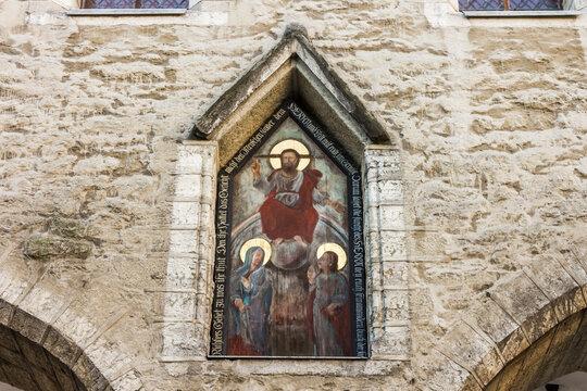 Tallinn, Estonia. Painting of Saint Peter of Verona in the facade of Tallinn Town Hall (Tallinna raekoda)