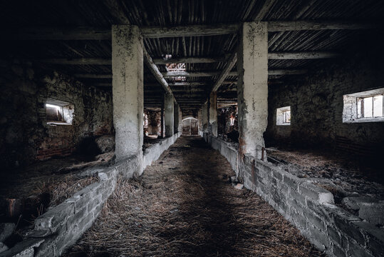 Old abandoned and spooky barn interior. One of buildings of Panemunis manor in Lithuania.