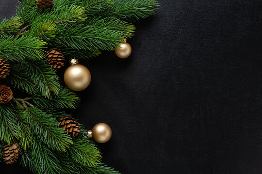 Christmas deco with fir and baubles on dark