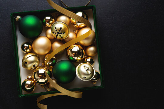 Christmas deco box with baubles on dark