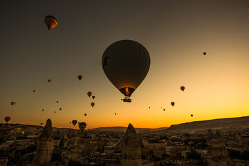 Stunning shot of hot air balloons flying over the Cappadocia region in Turkey