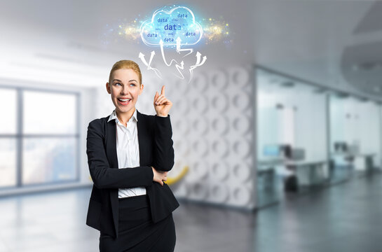 businesswoman interacting with a virtual cloud in front of an office background