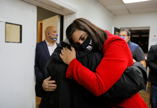 Republican congressional candidate for New York's 11th district, Nicole Malliotakis, is embraced by her father George at the Staten Island Republican Party Headquarters election night watch party on Staten Island in New York City