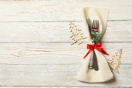 Napkin with New year cutlery on wooden background