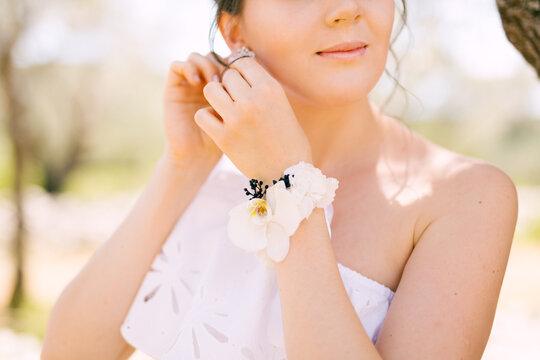 beautiful tender bride put an earring in her ear