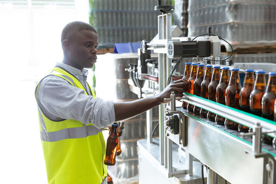 African American man working in a brewery