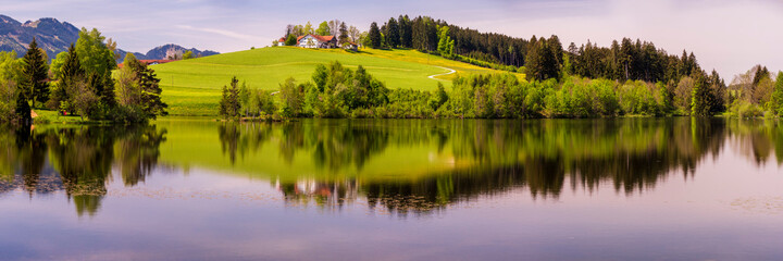 panoramic landscape in Bavaria with alps mountains and meadow at springtime