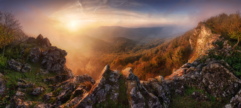 Dramatic sunrise in mountains with fog and sun - landscape panorama, Slovakia