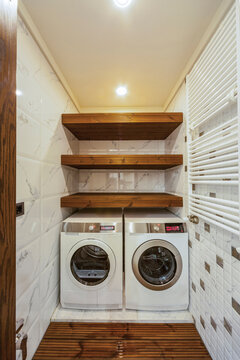 Home laundry with two washing machines