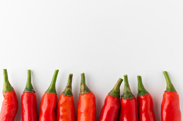 Red hot chili peppers arranging with white background and blank space. Garnish and food ingredients.