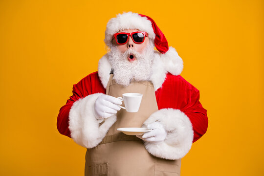 Close-up portrait of his he nice attractive amazed wondered astonished Santa shop owner businessman drinking cappuccino cafe cafeteria taste isolated bright vivid shine vibrant yellow color background