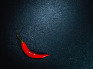 Slate plate with a red hot pepper