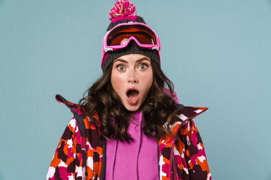 Shocked young woman wearing snowboard jacket