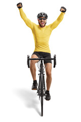 Male cyclist riding a road bicycle towards the camera and gesturing happiness
