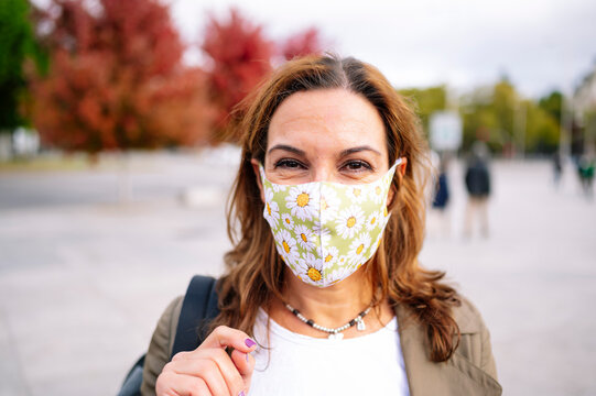Woman wearing a fabric face mask in the city