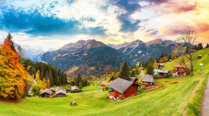 Gorgeous panorama over picturesque alpine village Wengen at autumn.