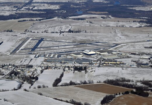 Aerial view of the Brantford Municipal airport in southern Ontario, view of the runways and hangars, light snow cover on the ground, Canada