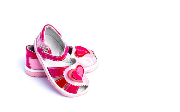 Children's shoes with a red heart. Isolated on white background.
