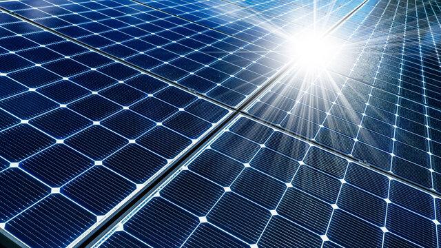Close-up of solar panels reflecting sun