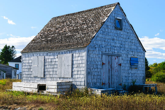 Old rustic wooden shingled shed in the country side of rural Nova Scotia, Canada.