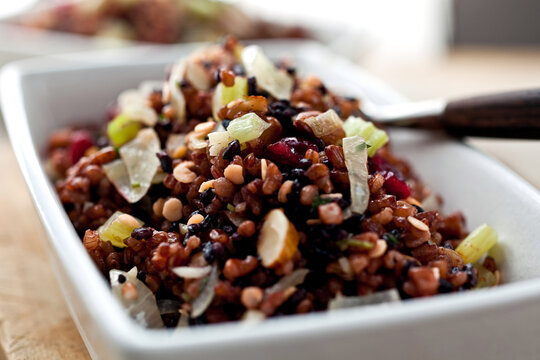 Close up of red and black rice stuffing with red lentils, almonds and cranberries served in bowl