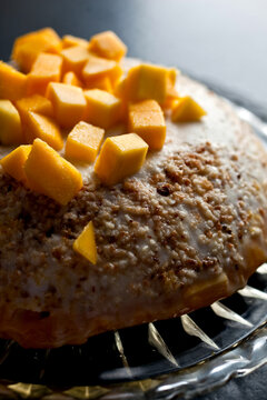 Close up of coconut macaroon and mango bombe served on plate