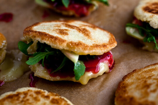 Close up of cranberry brie arepa sandwich