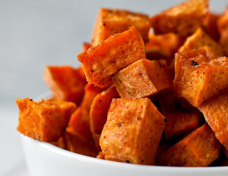 Close up of coconut oil roasted sweet potatoes served in bowl