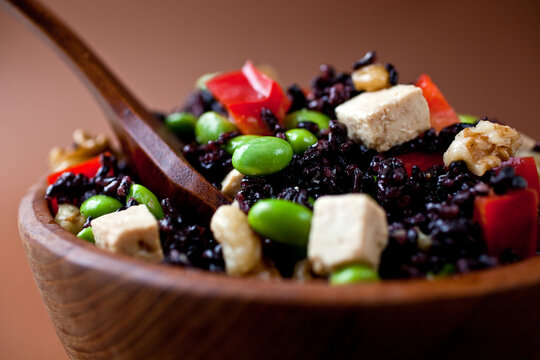 Close up of black rice and soy salad with Asian dressing served in bowl