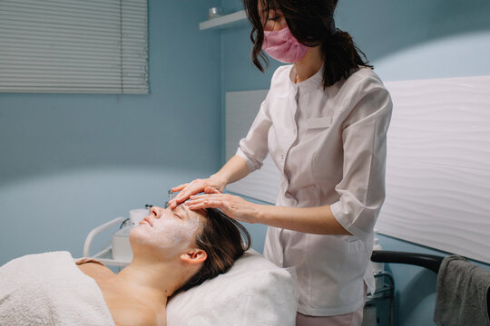 Cosmetician doing face massage