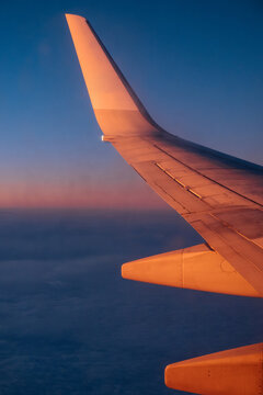 Plane airfoil during flight in sunlight