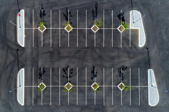 Aerial top down view of black asphalt car park