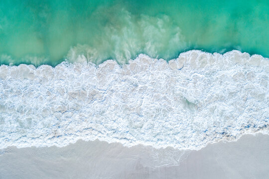 Aerial top down views of sandy beach in summer