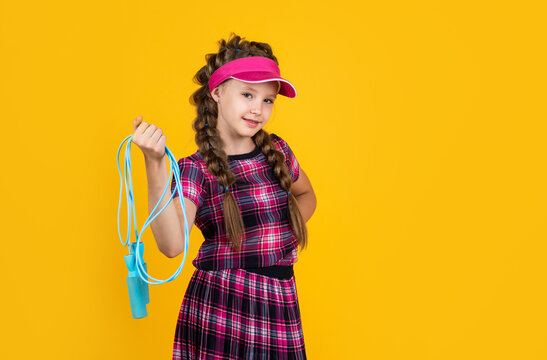 sport tools and equipment. teen girl do training. dedicated to fitness. healthy and active lifestyle. full of energy. happy childhood. kid in cap hold skipping rope. child with jumping rope