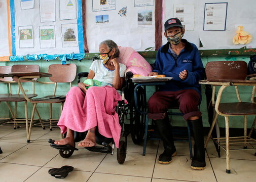 An elderly couple who was evacuated from their homes is pictured at a school public being used as a shelter after Storm Eta swept the Nicaraguan Caribbean coast in Masachapa