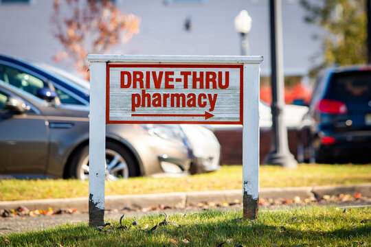 Drive-through pharmacy outdoor sign at sunny day