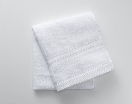 A towel placed on a white background. View from above