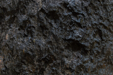 Wall Mural - rough dark stone texture for background and design