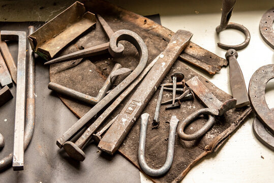 old rusty metal tools and pieces in a workshop