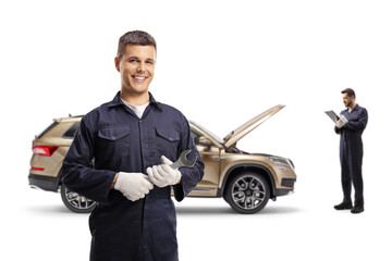 One auto mechanic with a wrench and other repairing a SUV Wall mural