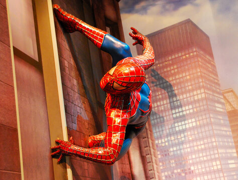 Amsterdam / Netherlands - August 8, 2015: Spider-man life size statue isolated on city buildings background