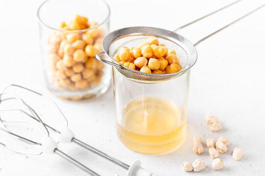 Chickpea liquid brine draining, aquafaba. Replace egg for vegan recipe