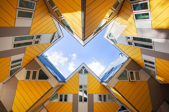 Yellow cubic houses or kubuswoningen by architect Piet Blom on the Overblaak in Rotterdam