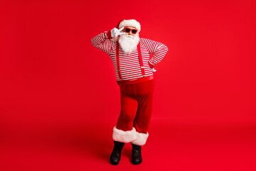 Full length body size view of his he nice handsome cheery comic childish flirty Santa father having...