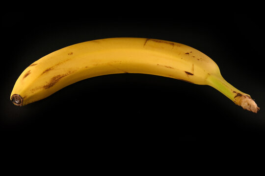 Yellow banana on a black background
